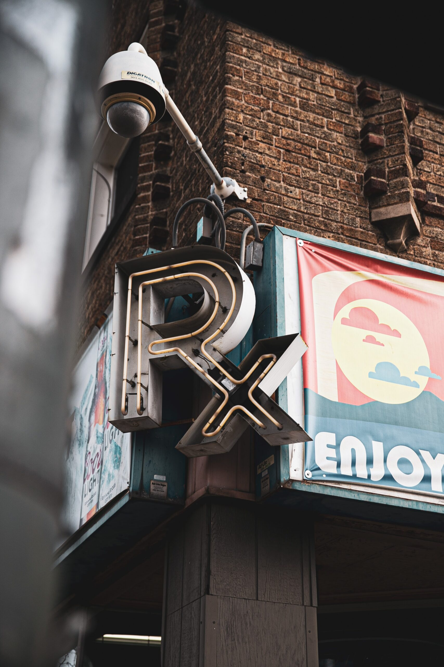 Rx sign on brick building